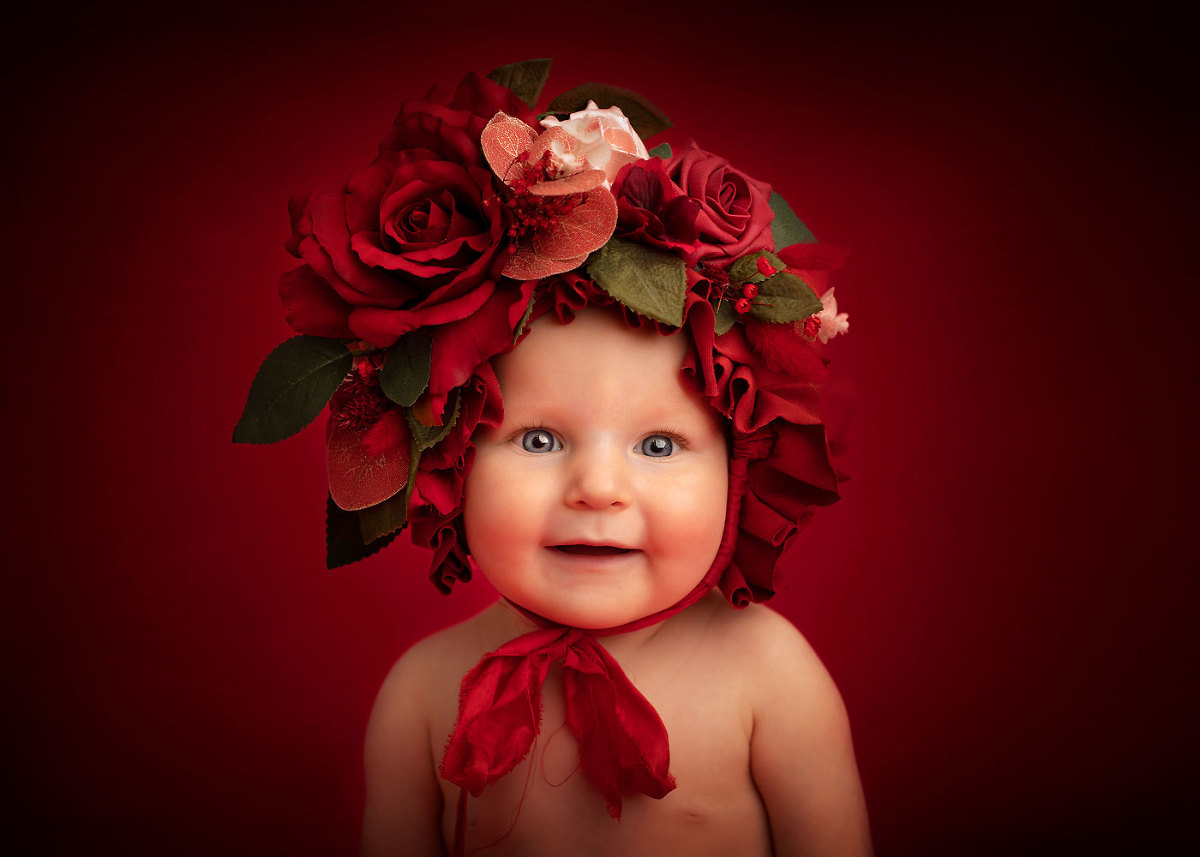 Beautiful baby in bonnet - best sussex baby photographers Baby Shoots Photography